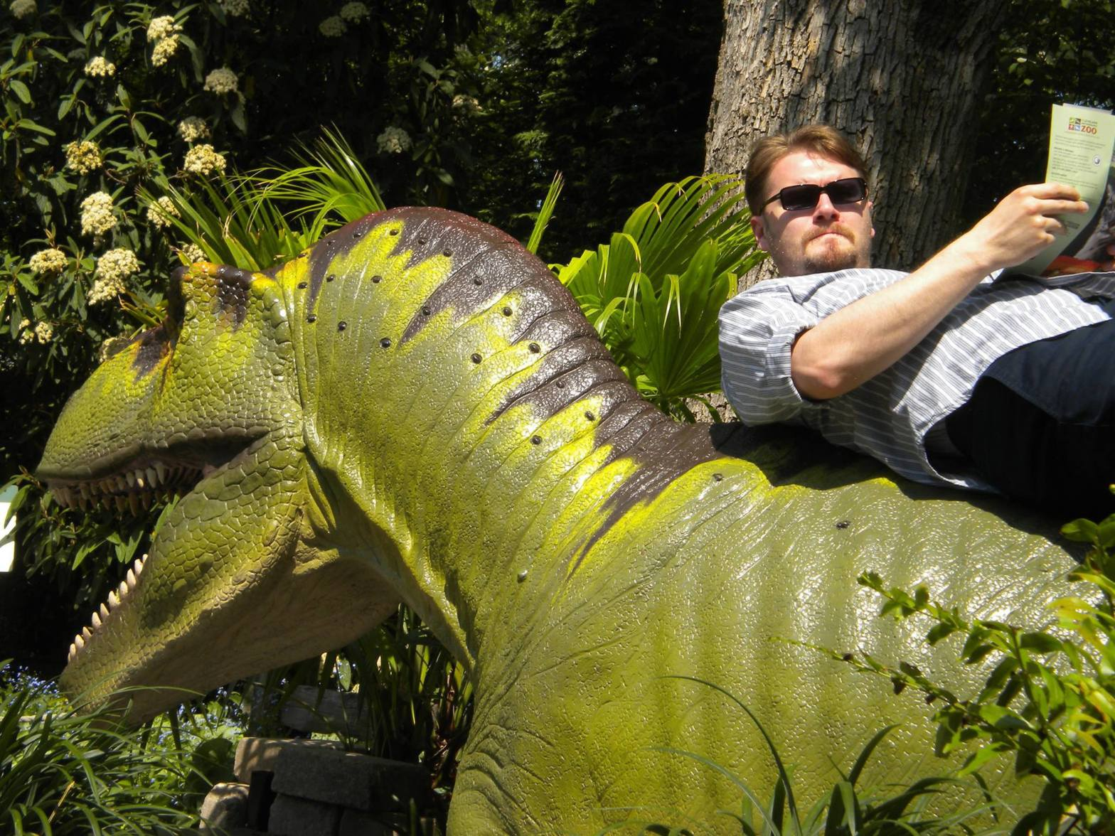 Alex Friedman sitting on top of a dinosaur.