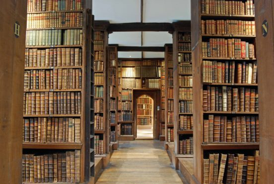view down the aisle of an old library